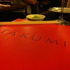 Photo taken at Takumi Japanese Diner by Kim v. on 6/15/2012