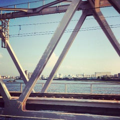 Photo taken at JR 下神崎川橋梁 by Izumi T. on 8/10/2012
