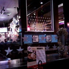 Photo taken at TGI Fridays by Emily V. on 12/31/2011