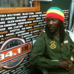 Photo taken at Boomchampionstt 94.1FM by Selvon F. on 12/20/2011