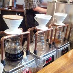 Photo taken at Intelligentsia Coffee by Mark M. on 8/9/2012