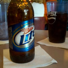 Photo taken at The Pour House Bar & Grill by Spence D. on 8/17/2011