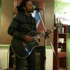 Photo taken at New Grounds Roasting Company by Ashley B. on 4/23/2011