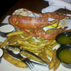 Photo taken at Beach House Grill and Bar by Alex H. on 1/19/2012