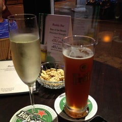 Photo taken at Buddy Bar & Café by D C. on 6/10/2012