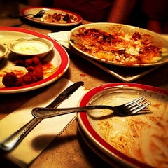 Photo taken at Ninety Nine Restaurant by Tom B. on 10/7/2012