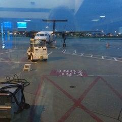 Photo taken at Gate F19 by Tim J. on 5/8/2014
