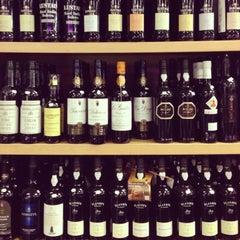 Photo taken at Pogo's Wine & Spirits by Ron R. on 1/8/2013