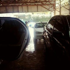 Photo taken at Miracle Car Wash by Iya E. on 2/16/2013