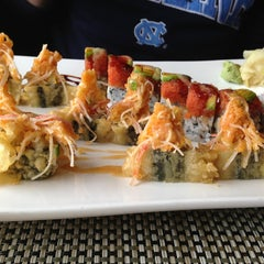Photo taken at Wild East Pan-Asian Bistro by Bonnie M. on 12/25/2012