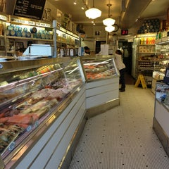 Photo taken at Russ & Daughters by Nicole W. on 2/25/2013