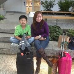 Photo taken at Passenger Terminal Building / Cheong Tat Road Bus Stop 機場客運大樓/暢達路巴士站 by Joel C. on 4/8/2013
