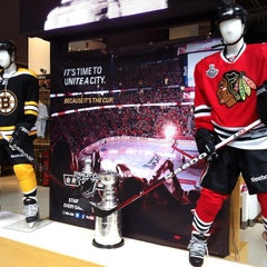 Photo taken at NHL Store Powered by Reebok by Ashley H. on 6/18/2013