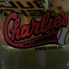 Photo taken at Charlie's Bar & Restaurant by Jack G. on 6/19/2013