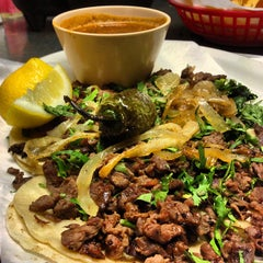 Photo taken at Taqueria Jalisco by Jeremy R. on 6/20/2013