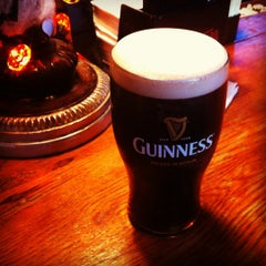 Photo taken at Sláinte Irish Pub by Izzak11 A. on 10/30/2012