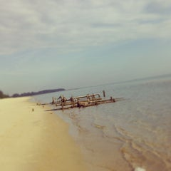 Photo taken at Demong Beach Resort by Muizz R. on 5/21/2014