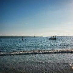 Photo taken at Pantai kelan by Esther L. on 2/15/2015