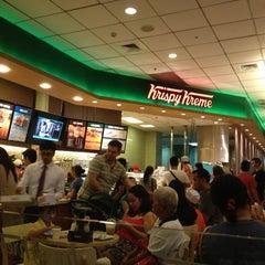 Photo taken at Krispy Kreme by Emerson N. on 2/14/2013