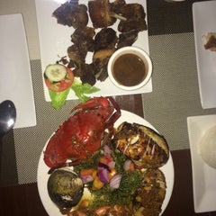 Photo taken at Kawayanan Grill by Ethan J. on 3/21/2015