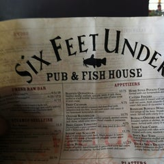 Photo taken at Six Feet Under Pub & Fish House by Frank W. on 5/17/2013