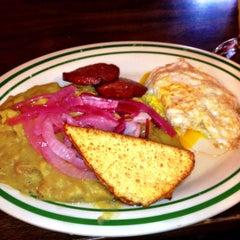 Photo taken at Caridad Restaurant by Oscar M. on 9/25/2012