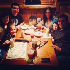 Photo taken at Outback Steakhouse by Elizabeth R. on 1/5/2014