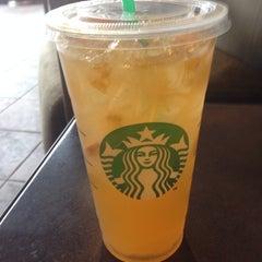 Photo taken at Starbucks by Ken O. on 3/29/2014