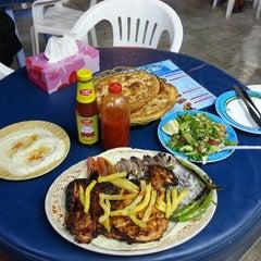 Photo taken at Al Karawan Restaurant by Sercan S. on 4/4/2013