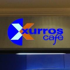 Photo taken at Xurros Café by Alejandro V. on 4/14/2013