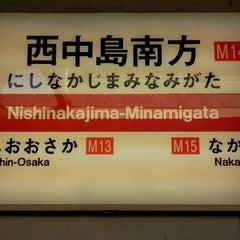 Photo taken at 西中島南方駅 (Nishinakajima-Minamigata Sta.) (M14) by Miyuki S. on 1/1/2013