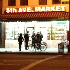 Photo taken at Fifth Avenue Market by lisa k. on 1/1/2013