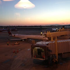 Photo taken at Delta Sky Club by Chris B. on 4/25/2013
