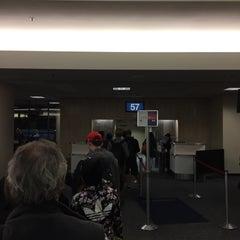 Photo taken at Gate 57 by Nick B. on 1/1/2015