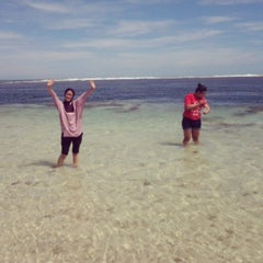 Photo taken at Pantai Ujung Genteng by Dian R. on 5/14/2013