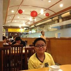 Photo taken at Laota Restaurant by Agatha N. on 5/9/2013