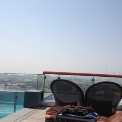 Photo taken at Hilton Dubai Roof Pool by Thiago V. on 9/14/2012