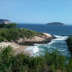 Photo taken at Praia do Sossego by Cris R. on 1/5/2013