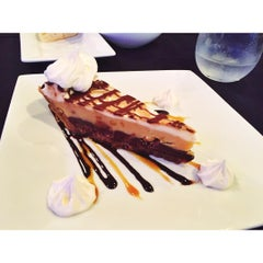 Photo taken at YOLO Restaurant + Lounge by Hannah D. on 7/29/2015