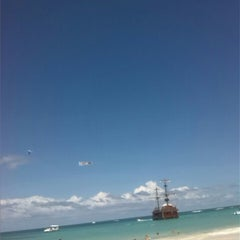 Photo taken at Los Corales Beach by Carlos T. on 3/22/2015