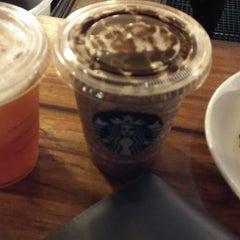 Photo taken at Starbucks by Edward J. on 1/3/2015