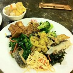 Photo taken at Lotus Vegetarian Restaurant by Walter L. on 6/14/2013
