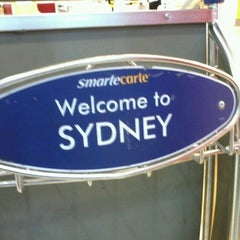 Photo taken at T1 International Terminal (SYD) by Cynthia O. on 11/14/2012