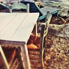 Photo taken at Παραλία Κινίου (Kini Beach) by Terezdina R. on 5/25/2013