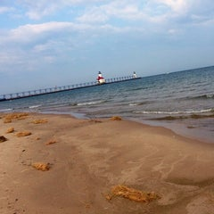 Photo taken at St. Joseph North Pier (at Tiscornia Park) by M-A on 7/31/2014