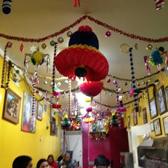 Photo taken at Tacomiendo by Eric N. on 12/21/2012