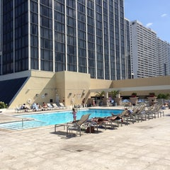 Photo taken at Hilton Hotel Rooftop Pool by Brian B. on 4/12/2014