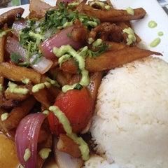 Photo taken at Mamita Peruvian Restaurant by Giselle M. on 5/25/2013