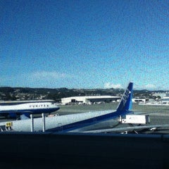 Photo taken at Gate G101 by Adam T. on 12/18/2012