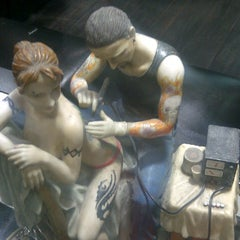 Photo taken at American Tattoo (Bond Street) by Gise ® on 3/23/2013